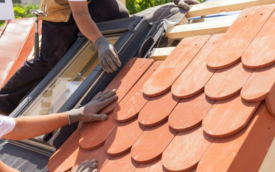 Roof tiles being repaired